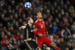 (l-r) Daley Blind of Ajax, Mats Hummels of FC Bayern Munchen during the UEFA Champions League group E match between Bayern Munich and Ajax Amsterdam at the Allianz Arena on October 02, 2018 in Munich, Germany