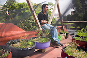 Rodrigo Canavas, director of Azoteas Verdes (Green Roofs), poses with his demo garden on the roof of the Centro Cultural La Pyramide in Mexico City, Mexico on June 17, 2008. His organization promotes roof garden construction throughout the city, teaching workshops, collecting used containers and preparing compost from organic waste.