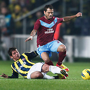 Fenerbahce's Emre Belozoglu (L) and Trabzonspor's Alan Carlos Gomes Da Costa (R) during their Turkish superleague soccer derby match Fenerbahce between Trabzonspor at the Sukru Saracaoglu stadium in Istanbul Turkey on Sunday 18 December 2011. Photo by TURKPIX