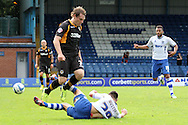 Bury's Jordan Mustoe slides in to tackle Newport County's Adam Chapman. Skybet Football League two match, Bury v Newport county at Gigg Lane in Bury on Saturday 5th Oct 2013. pic by David Richards, Andrew Orchard sports photography,
