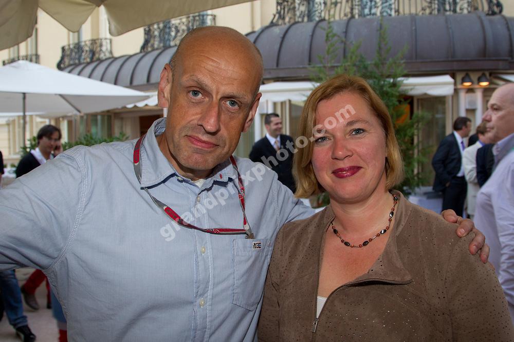 Alexandra Schieren (Pirelli press officer) Peter Nygaard (Grand Prix Photo) before the 2012 Monaco Grand Prix. Photo: Grand Prix Photo