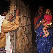 After all the children under five in a household have been immunized, health workers mark the house to show it has been covered, on a river island, a Char, in the middle of the Brahmaputra river in the north eastern state of Assam.