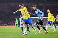 Brazil defender Filipe Luis (6) and Uruguay midfielder Rodrigo Bentancur (6) during the Friendly International match between Brazil and Uruguay at the Emirates Stadium, London, England on 16 November 2018.