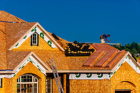 Construction workers building a new house, Littleton, Colorado USA.