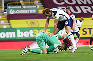 Burnley goalkeeper Nick Pope (1)smothers the danger from Tottenham Hotspur forward Harry Kane (10) during the Premier League match between Burnley and Tottenham Hotspur at Turf Moor, Burnley, England on 26 October 2020.