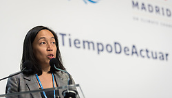 4 December 2019, Madrid, Spain: World Council of Churches staff Athena Peralta moderates a press conference held at COP25, reporting on the findings of an interfaith dialogue on 1 December.