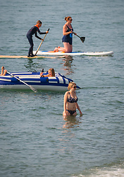 © Licensed to London News Pictures. 10/06/2018. Aberystwyth, UK. People at the seaside in Aberystwyth , west Wales, enjoying yet another afternoon of hot summer sunshine, as temperatures soar. Photo credit: Keith Morris/LNP