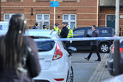 © Licensed to London News Pictures. 20/02/2018. LONDON, UK.  Police officers and a forensics team attend the scene in Halliday Square, Southall, West London, where a 26 year old man was fatally stabbed on the afternoon of 19 February.  A 39 year old man was arrested at the scene and is in custody.  Investigations are ongoing.  Photo credit: Stephen Chung/LNP
