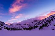 Sunset over the Sierra crest in winter, John Muir Wilderness, Sierra Nevada Mountains, California  USA