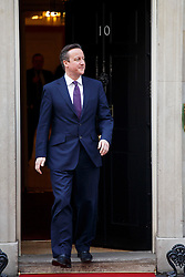 © licensed to London News Pictures. London, UK 27/02/2014. Prime Minister David Cameron welcomes German Chancellor Angela Merkel on Downing Street, London on Thursday, 27 February 2014. Photo credit: Tolga Akmen/LNP