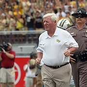 UCF Knights head coach George O'Leary enters the field prior to an NCAA football game between the South Carolina Gamecocks and the Central Florida Knights at Bright House Networks Stadium on Saturday, September 28, 2013 in Orlando, Florida. (AP Photo/Alex Menendez)