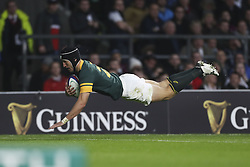 November 12, 2016 - London, England, United Kingdom - Johan Goosen of South Africa dives to score a try for South Africa late on during Old Mutual Wealth Series between England  and South Africa played at Twickenham Stadium, London, November 12th  2016  (Credit Image: © Kieran Galvin/NurPhoto via ZUMA Press)