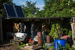 Sipson, UK. 5th June, 2018. Solar panels are used above a storage area at Grow Heathrow. Grow Heathrow is a squatted off-grid eco-community garden founded in 2010 on a previously derelict site close to Heathrow airport to rally support against government plans for a third runway and it has since made a significant educational and spiritual contribution to life in the Heathrow villages, which remain threatened by Heathrow airport expansion.