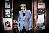 An elderly man standing in a doorway, Sorrento, Italy.