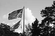 BIRMINGHAM, AL –SEPTEMBER, 2017: An American flag waves outside of a commercial offset printing plant.