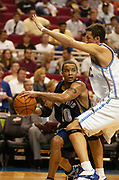 November 4, 2005, Orlando, Florida, USA;  Damon Stoudamire of the Memphis Grizzlies looks for an open man as he is defended by Hedo Türkoglu of the Orlando Magic.  The Grizzlies defeated the Magic 94-85.