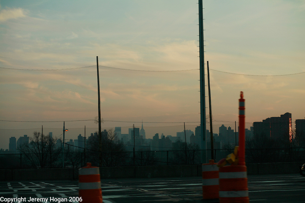 Barriers block the view of New York City seen from the Long Island Expressway. ..