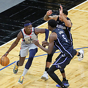 ORLANDO, FL - APRIL 07: Isaac Bonga #17 of the Washington Wizards dribbles the ball against Mo Bamba #5 of the Orlando Magic and Chuma Okeke #3 of the Orlando Magic during the second half at Amway Center on April 7, 2021 in Orlando, Florida. NOTE TO USER: User expressly acknowledges and agrees that, by downloading and or using this photograph, User is consenting to the terms and conditions of the Getty Images License Agreement. (Photo by Alex Menendez/Getty Images)*** Local Caption *** Isaac Bonga; Mo Bamba; Chuma Okeke