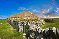 Picture & image of the exterior with stone walls and thatched roof of The historic Blackhouse, 24 Arnol, Bragar, Isle of Lewis, Scotland. .<br /> <br /> Visit our SCOTLAND HISTORIC PLACXES PHOTO COLLECTIONS for more photos to download or buy as wall art prints https://funkystock.photoshelter.com/gallery-collection/Images-of-Scotland-Scotish-Historic-Places-Pictures-Photos/C0000eJg00xiv_iQ