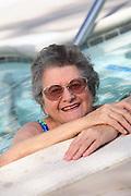 Senior Woman Exercising at the Pool