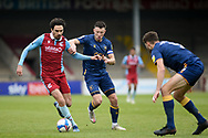Scunthorpe United Alex Gilliead (8) Mansfield Town Ollie Clarke (8) battles for possession during the EFL Sky Bet League 2 match between Scunthorpe United and Mansfield Town at the Sands Venue Stadium, Scunthorpe, England on 26 December 2020.