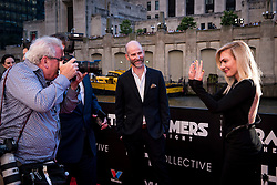 An attendees shows off her nails to photographers at the US Premier of 'Transformers: The Last Knight' at on the Chicago River in front of the Civic Opera House on Tuesday June 20, 2017 in Chicago, IL. Photo: Christopher Dilts / Sipa USA *** Please Use Credit from Credit Field ***