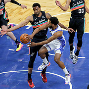 ORLANDO, FL - APRIL 12: Chasson Randle #25 of the Orlando Magic passes the ball past Keita Bates-Diop #31 of the San Antonio Spurs during the second half at Amway Center on April 12, 2021 in Orlando, Florida. NOTE TO USER: User expressly acknowledges and agrees that, by downloading and or using this photograph, User is consenting to the terms and conditions of the Getty Images License Agreement. (Photo by Alex Menendez/Getty Images)*** Local Caption *** Chasson Randle; Keita Bates-Diop