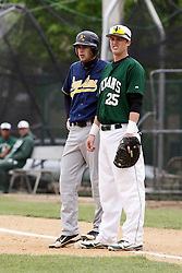 28 April 2012:  Baserunner Jacob VanDuyne stands on the bag next to first baseman Bobby Czarnowski during an NCAA division 3 Baseball game between the Augustana Vikings and the Illinois Wesleyan Titans in Jack Horenberger Stadium, Bloomington IL