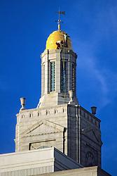 Men Working On Top Of Building