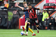 Arnaut Danjuma (10) of AFC Bournemouth battles for possession with Sam Clucas (22) of Stoke City during the EFL Sky Bet Championship match between Bournemouth and Stoke City at the Vitality Stadium, Bournemouth, England on 8 May 2021.