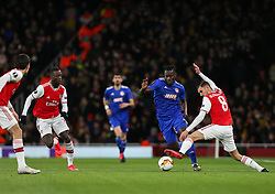 Mady Camara of Olympiacos dribbles past the outstretched leg of Dani Ceballos of Arsenal - Mandatory by-line: Arron Gent/JMP - 27/02/2020 - FOOTBALL - Emirates Stadium - London, England - Arsenal v Olympiacos - UEFA Europa League Round of 32 second leg