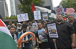 April 13, 2018 - Kuala Lumpur, Kuala Lumpur, Malaysia - Muslim demonstrators shout slogans as they hold placards during 'Great Return March' rally outside the U.S. embassy in Kuala Lumpur. (Credit Image: © Kepy via ZUMA Wire)