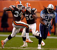 MORNING JOURNAL/DAVID RICHARD.Cleveland running back Reuben Droughns finds open field while being chased by the Tennessee defense yesterday in the third quarter.