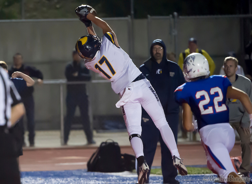 Oak Ridge Trojans Austin Eastman (17), catches the ball  for a touchdown making the score 17-16 but fumbled the point after attempt to lose the game during the fourth quarter as the Folsom High School Bulldogs varsity football team host the Oak Ridge High School Trojans,  Friday Nov 4, 2016.<br /> photo by Brian Baer