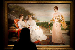 © Licensed to London News Pictures. 08/12/2011. London, UK. Charles Edward Perugini's 'The ramparts, Walmar Castle, portraits of the Countess Granville, and the ladies Victoria and Mary Leveson-Gower (est £150,000-200,000) on display at Christie's where it will be auctioned off on 15th December, the auction is expected to realise in excess of £4.5million.  Photo credit : James Gourley/LNP