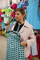 Young woman subjected to consumer spending pressure,