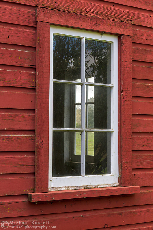 Windows on the red Gambrel Roof Barn (built in 1939) on Len Rowlatt's farmland in Langley.  This farmland was first used by Joseph and Sarah Anne Annand and later by Len Rowlatt until his death in 1972.  The property is now part of Campbell Valley Regional Park in Langley, British Columbia, Canada.