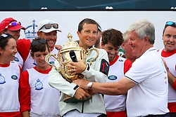 Bear Grylls is awarded the King's Cup during the prize giving following the the King's Cup regatta at Cowes on the Isle of Wight. The The Duke of Cambridge and The Duchess of Cambridge went head to head in the regatta in support of their charitable causes.