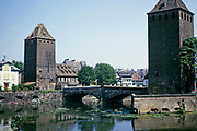 Towers of the medieval bridge Ponts Couverts over the river Ill in the Petite France quarter of city Strasbourg, France 1974
