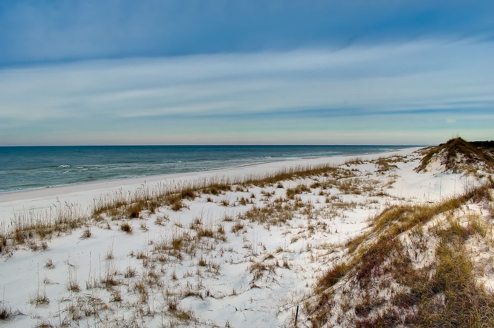 Photograph of the Gulf of Mexico, photographed from atop one of the 25-foot dunes that parallel the coast (using the boardwalk of course - it is illegal to walk on the dunes themselves for several ecological and environmental reasons).