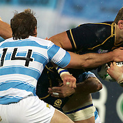 John Barclay, Scotland, is tackled by Gonzalo Camacho, Argentina,  during the Argentina V Scotland, Pool B match at the IRB Rugby World Cup tournament. Wellington Regional Stadium, Wellington, New Zealand, 25th September 2011. Photo Tim Clayton...