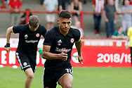 Brentford Forward Ollie Watkins (11) warms up before kick off during the EFL Sky Bet Championship match between Brentford and Queens Park Rangers at Griffin Park, London, England on 21 April 2018. Picture by Andy Walter.