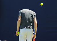Tennis - 2018 Queen's Club Fever-Tree Championships - Day One, Monday<br /> <br /> Andy Murray ducks as a ball flies over his head during training, on Court 7.<br /> <br /> COLORSPORT/ANDREW COWIE