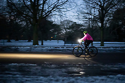 © Licensed to London News Pictures. 10/02/2021. London, UK. A member of the public exercises in a snowy Greenwich Park in South East London. Snow is expected for large parts of the UK and a yellow weather warning is in place across the east of England as Storm Darcy hits the UK. Photo credit: George Cracknell Wright/LNP