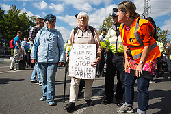 London, UK. 3 September, 2019. Police officers arrest protesters, including many Quakers, blocking one of the two main access roads to ExCel London on the second day of week-long protests against DSEI, the world's largest arms fair. Protests were themed around faith and prayer and involved believers deriving from multiple faiths including the Quakers standing in solidarity against arms sales.