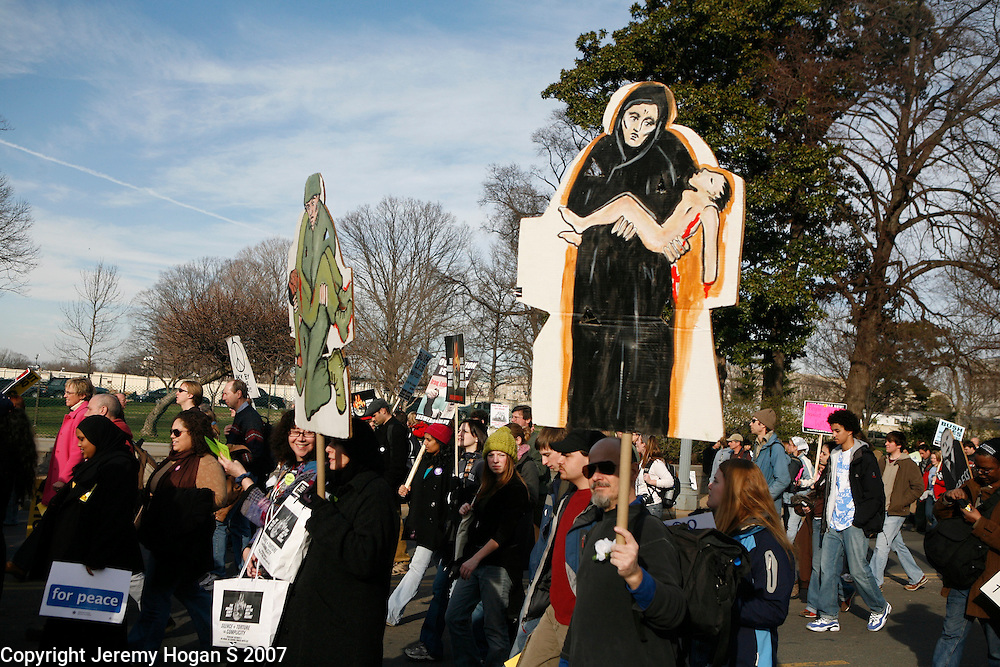 Over 100,000 anti-war protesters gathered on the Washington Mall and then marched on a route around the U.S. Capitol.