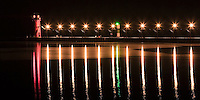 The calm of Lake Michigan creates a watery mirror of the South Haven Pier and Lighthouse