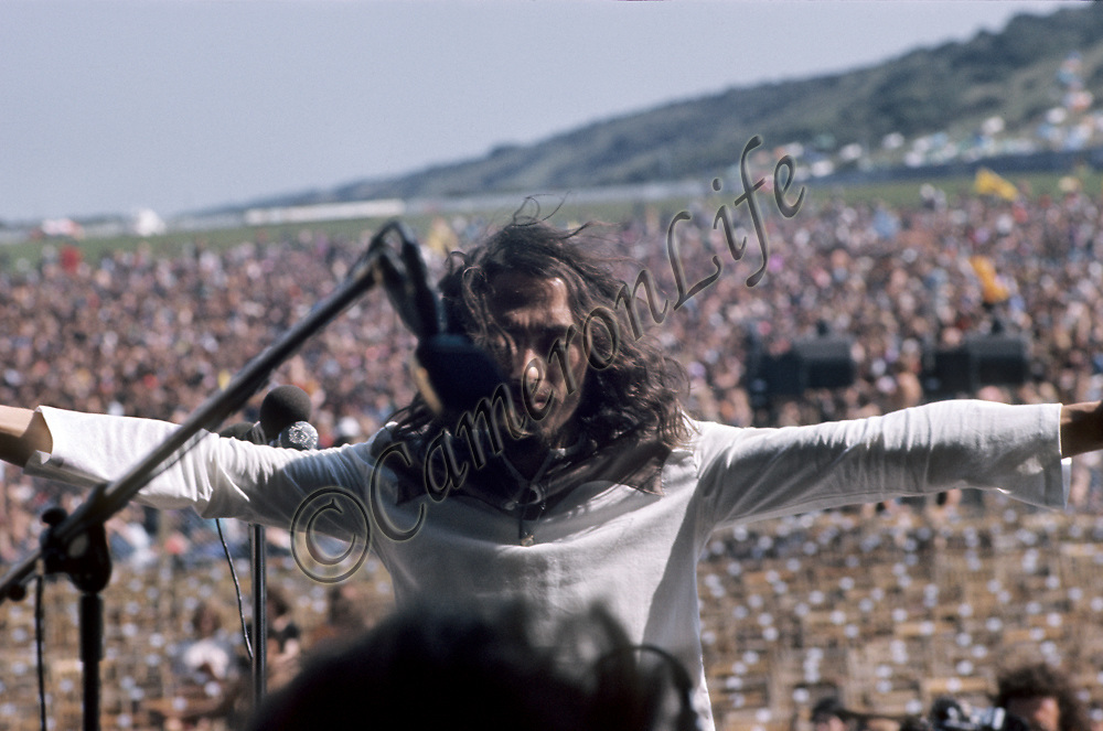 Peter Daltrey - Fairfield Parlour.- .Fairfield Parlour opened the festival officially at around 2 o'clock that afternoon. Threats had already been made at this time, indicating that the first band on stage would be shot at. Lead singer Peter Daltrey responded to this by turning his back on the audience to 'taunt' the would-be assassin. Thankfully it had all been hot air, or there would have been no festival.