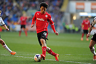 Cardiff City's Kim Bo-Kyung in action .Barclays Premier league, Cardiff city v Fulham at the Cardiff city Stadium in Cardiff , South Wales on Sat 8th March 2014. pic by Andrew Orchard, Andrew Orchard sports photography