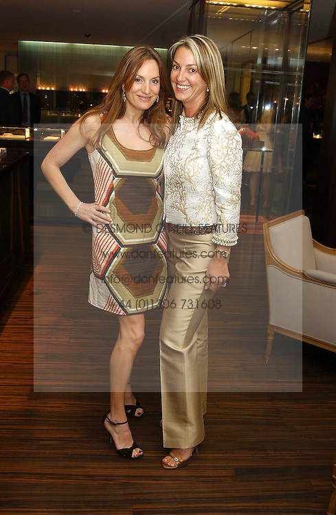 Left to right, EMILY OPPENHEIMER and BEATRICE WARRENDER at a party to celebrate the publication of 'The Russian House' by Ella Krasner held at De Beers, 50 Old Bond Street, London W1 on 9th June 2005.<br /><br />NON EXCLUSIVE - WORLD RIGHTS